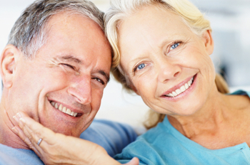 Closeup of a retired couple against bright background